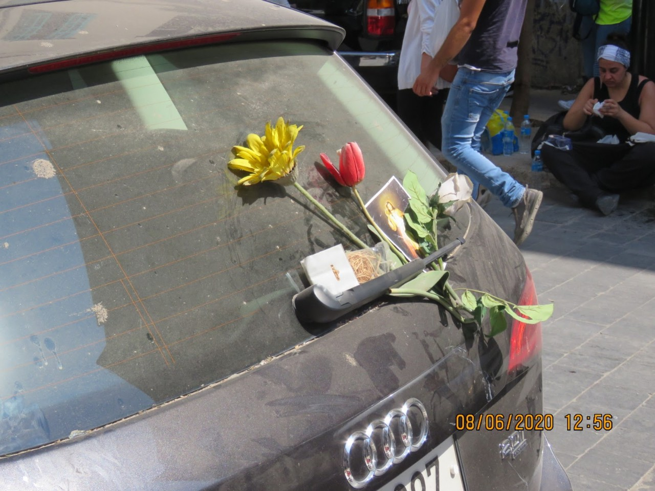 A memorial and prayer placed on the windshield of a car in Gemmayzeh, Lebanon, on August 6, 2020. Gemmayzeh was one of the areas that was severely damaged from the explosion. Photo by Hadil Dia (mindshapedbox)